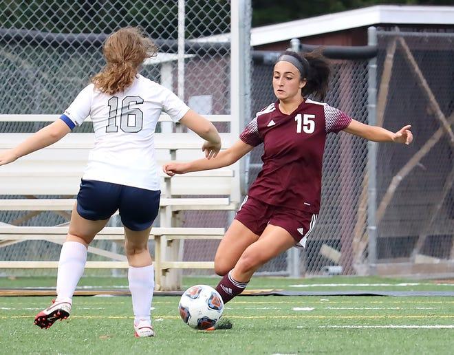 John Glenn's Marina Nicolozakes (15) dribbles the ball away from Morgan's Paige Gorrell (16) during MVL soccer action at John Glenn High School on Wednesday evening.
