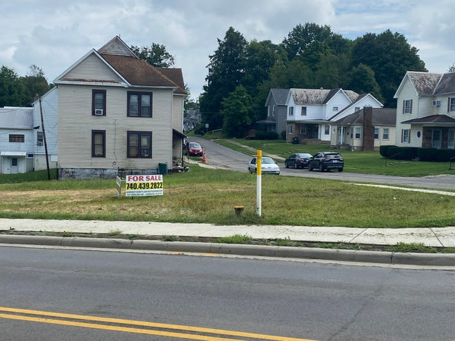 The Guernsey County Land Reutilization Corporation has set $40,000 as the selling price for three adjoining lots at the corner of Clark Street and Beatty Avenue in Cambridge.