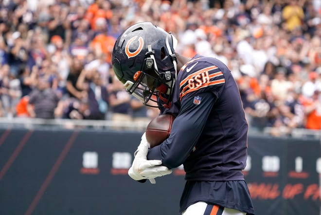 Chicago Bears wide receiver Rodney Adams rocks the football like a baby in his arms after catching a touchdown pass from quarterback Andy Dalton during the first half of a preseason game against the Buffalo Bills on Saturday, Aug. 21, in Chicago.