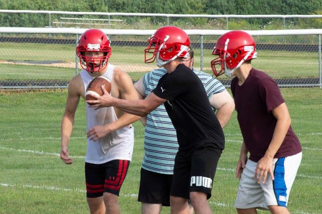 Camden-Frontier practices handoffs earlier in the pre-season.