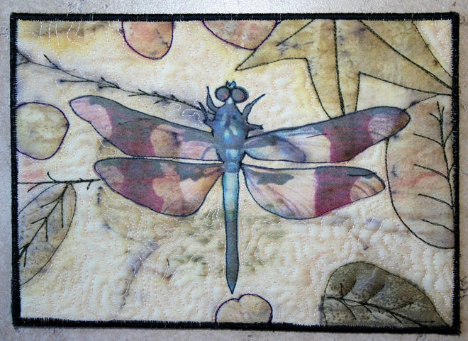 A dragonfly is featured in this art quilt by Lisa Dodson.
