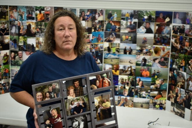 Lisa Beatty and her family compiled picture boards featuring dozens of family photos for the funeral of her husband, Rod Beatty, who died this month from COVID-19.