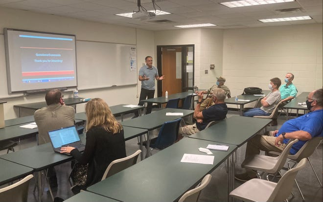 Matt Louth, a project manager with the Installation Restoration Program at Camp Lejeune, speaks at a Restoration Advisory Board meeting held at Coastal Carolina Community College in Jacksonville, Aug. 25, 2021.