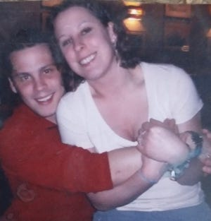 In this 2007 photo, Jonathan Goetz and sister Stephanie Goetz hug at a family get-together. Jonathan Goetz, known by family and friends for his upbeat humor, was found dead in his truck Sunday, Aug. 22, 2021, at Three Sisters Park in Chillicothe, where he had been working at the Summer Camp Music Festival.