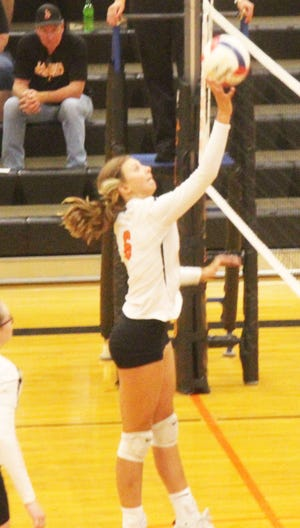 La Junta High School's Whitney Denahy hits the ball over the net in a match against Kim/Branson at Tiger Gym in La Junta, Colo., on Tuesday, Aug. 24, 2021.