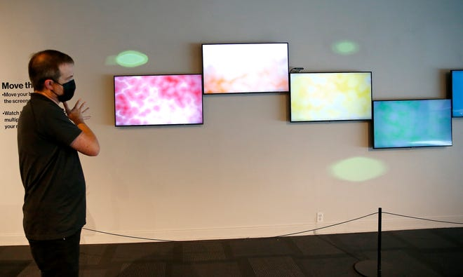Geoffrey Hicks talks about Chromawave at his art exhibit Screens at the Science Museum Oklahoma in Oklahoma City, Wednesday, Aug. 25, 2021.