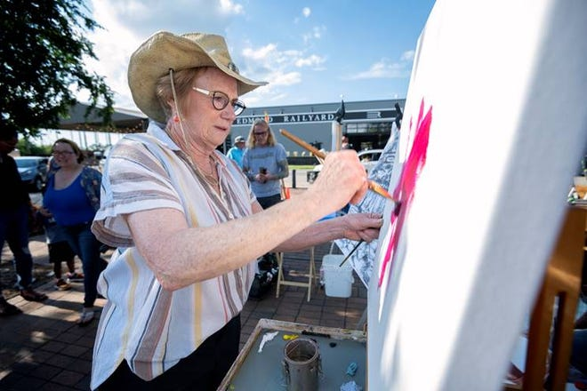 """Charl Adair paints during a """"Good VIBES"""" Paint Off in June in downtown Edmond."""