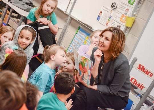 State schools Superintendent Joy Hofmeister reads with students in April 2019 at Rhoades Elementary in Broken Arrow Public Schools during Read Across America.