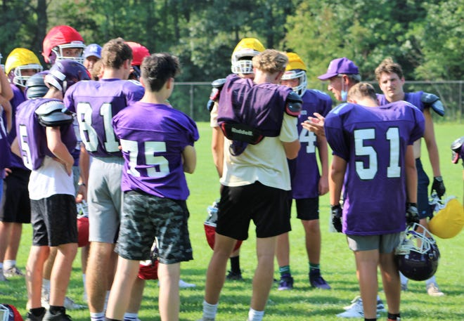 Marshwood High School football coach Alex Rotsko talks to his team during Wednesday's practice. Rotsko enters his ninth season, having led the Hawks to five of the past six Class B state championships.