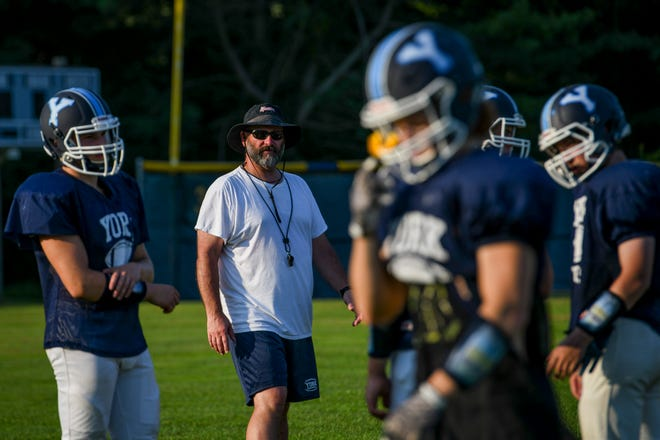 York High School football coach Matt Nelson oversees practice this week. The Wildcats open their Class C South season next Friday at home against Winslow.