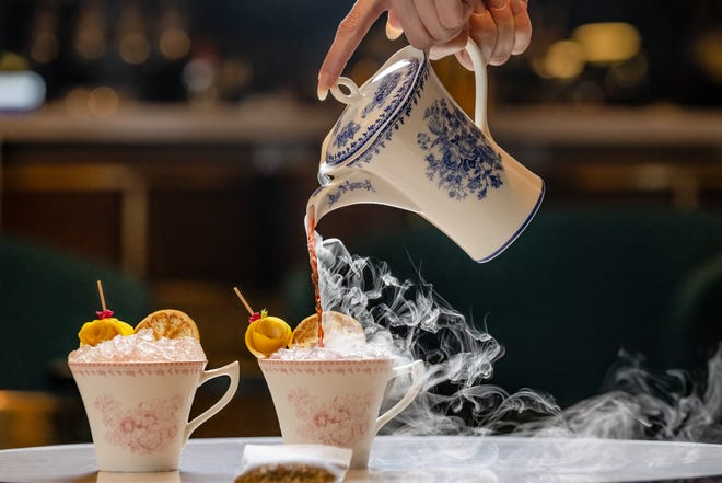 Dry ice adds the steamy visuals to a chilly Tee Time cocktail at The Ray hotel's Lobby Bar in Delray Beach. The drink combines hibiscus tea syrup, fresh lemon juice, plus strawberry and lemongrass-infused vodka, all shaken and poured tableside for two.