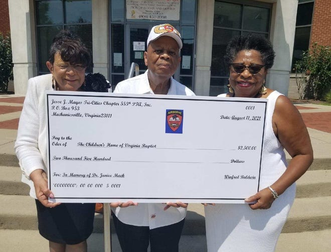 Jesse J. Mayes Tri-Cities Chapter of 555th Parachute Infantry Association, Inc. President John Boyd and member Gracie White present a $2,500 check to the Children's Home of Virginia Baptist at the Petersburg Public Library on Aug. 11, 2021. On the right, CHVB Director Erna G. Robinson.