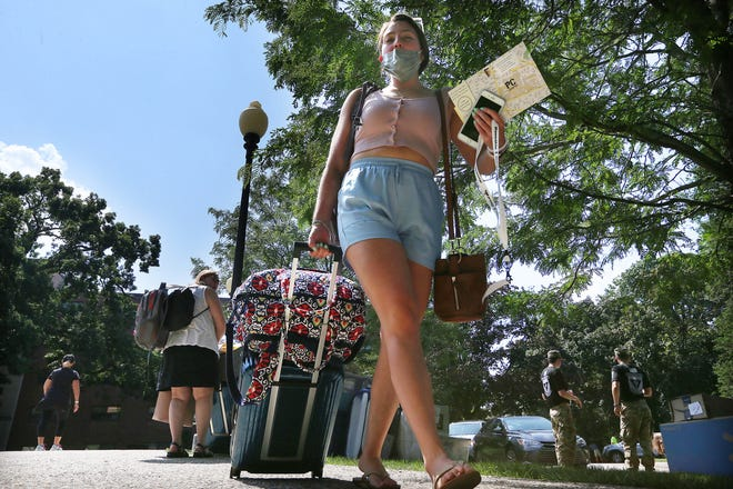 Amelia Thomas, from outside Baltimore, moves into Meagher Hall at Providence College on Thursday as students settle in for the year.