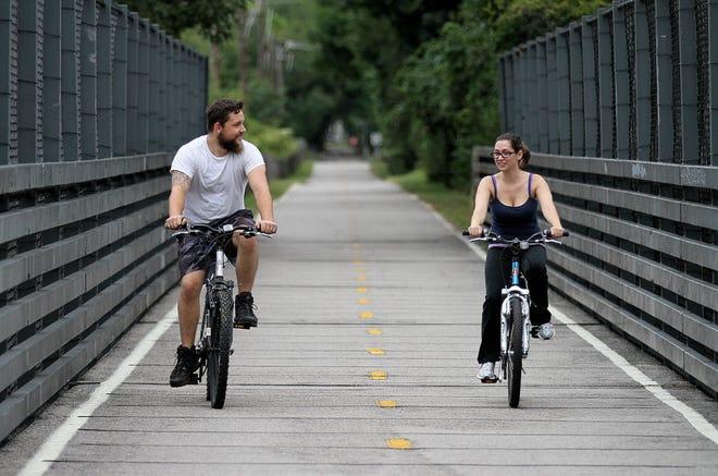 Bill Ball, left, and Sarah Polonczak, both of Pawtucket, ride the Washington Secondary Bike Path in West Warwick in 2015. At 19 miles, the Washington Secondary is the longest bike path in Rhode Island.