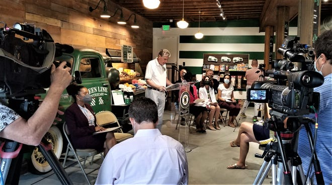 Gov. Dan McKee speaks at Green Line Apothecary in Providence.