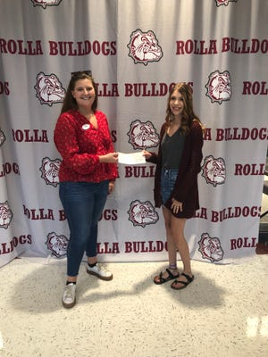 Pictured is Kristyn Young, Director of Outreach withthe Russell House (left) and Jaydan Barr, 2021 Rolla High School graduate and Leadership team member (right).