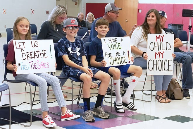 From right, Amanda Murphy, her son Levi Daniels, his buddy Brayden Speck, and Murphy's daughter Kailee Daniels attended a recent Crestwood Board of Education meeting during which the board voted down a proposed mask mandate.