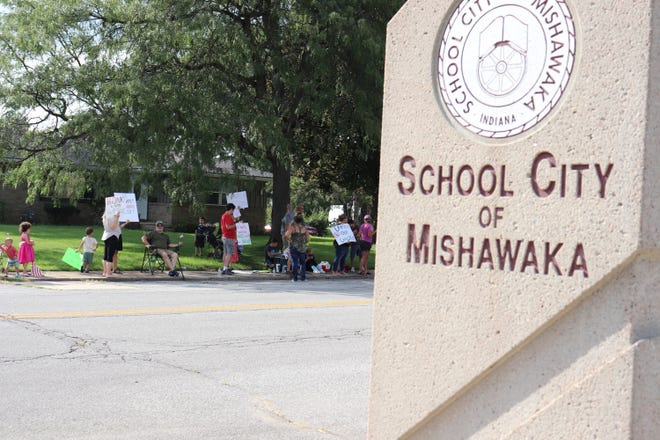 About 50 protesters appeared outside the School City of Mishawaka's board meeting on Wednesday, Aug. 25, 2021 at the district's Administrative Center.