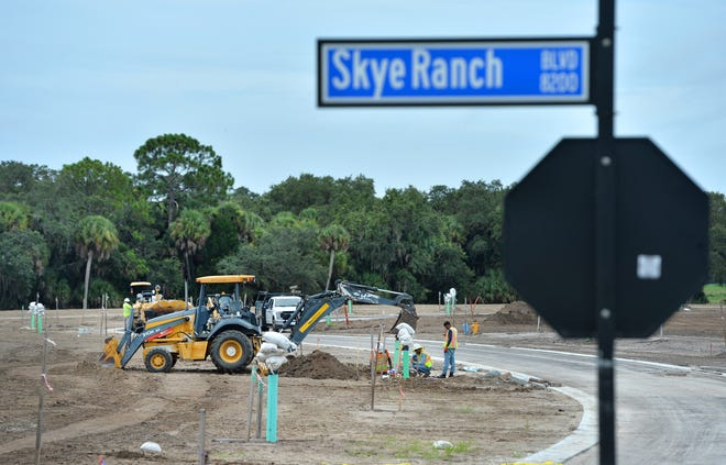 Utilities are being installed along new roads in Skye Ranch. Skye Ranch is a new residential development on Lorraine Rd., which has been extended south of Clark Rd. in Sarasota, Florida. When built out, the 1,000 acre community will consist of 1,200 single family homes and 360 townhomes.