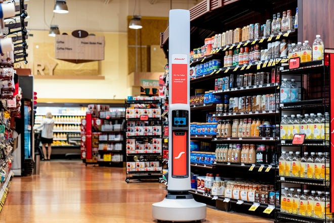 A Schnuck Markets Tally robot by Simbe Robotics is stationed in a store in Des Peres, Mo., on Aug. 13. The retail management assistant is being deployed in all Schnucks stores across the U.S., the company announced Thursday.