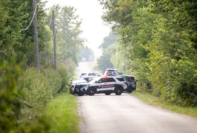 Sangamon County Sheriff's Deputies block off Mansion Road as they investigate the scene of a fatal car accident near the intersection with Curran Road northwest of Chatham, Ill., Wednesday, August 25, 2021. The Sangamon County Sheriff's Office announced that an unidentified woman was pronounced dead at the scene and an unidentified man was airlifted toHSHS St. John's Hospital after they were involved in the accident at about 3:05 p.m. [Justin L. Fowler/The State Journal-Register]