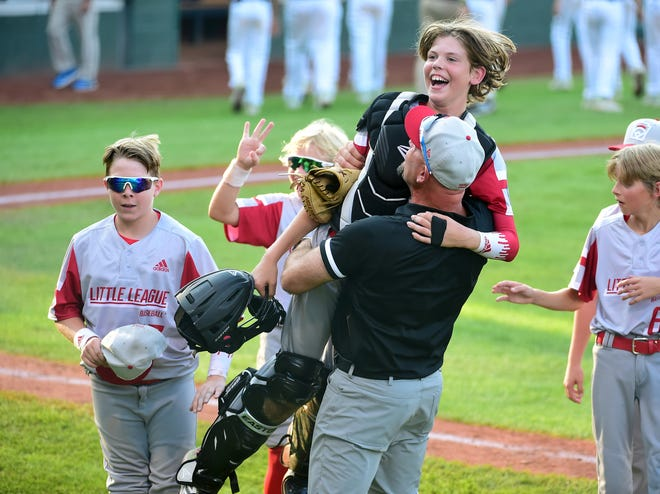 Sioux falls Little League catcher Easton Riley, holding his helmet, celebrates with teammates after beating California 1-0 Wednesday at Volunteer Stadium in Williamsport, Penn. The South Dakota team plays Ohio in the semifinals today at 11:30 a.m. on ABC.
