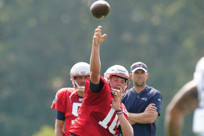 New England Patriots quarterback Mac Jones passes the ball during a joint NFL football practice with the New York Giants on Wednesday in Foxborough.