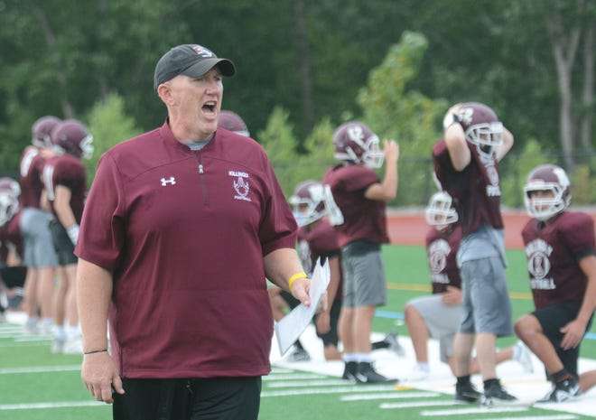 Killingly High School football coach Chad Neal directs his team during practice in Dayville.