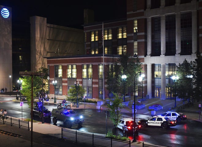 A complex chase scene filmed Wednesday night consisted of three police cruisers barreling down Main towards Lincoln Square to block a Humvee with a motocross bike and a driver on top Wednesday night.
