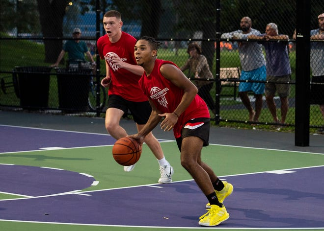 Sullivan, Garrity & Donnelly's Malakhi Knight of St. John's drives up the court during the championship game of the Kingsway Boys' Basketball Summer League at Crompton Park on Wednesday.