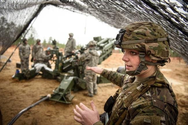 Then-1st Lt. Emily Bessler, a platoon leader with the 82nd Division Artillery, trains during a fire support and coordination exercise in December 2015. As combat roles have opened for women in the military, discussions about whether or not women should be required to register for the draft are once again being considered in Congress.