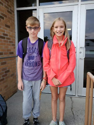 Brother and sister Zane and Emma Jane Shepard prepare for the first bell Thursday as classes started after a sweltering summer.
