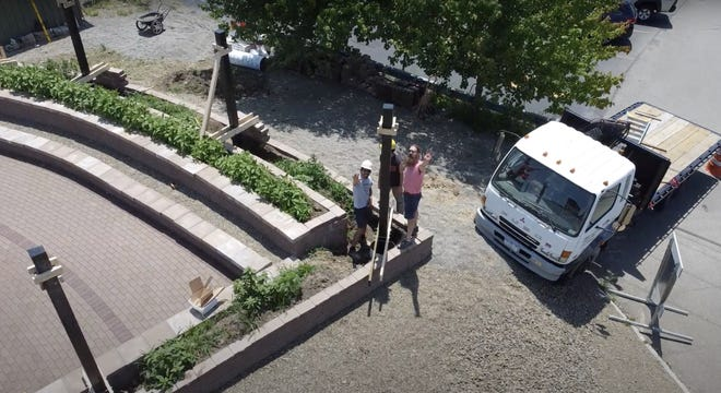 Glenn Zweygardt provides a crane to support pavilion construction at the Fassett GreenSpace.