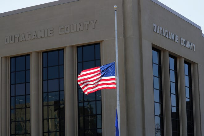 An American flag is flown at half-staff in front of the Outagamie County Government Center April 22 in Appleton.