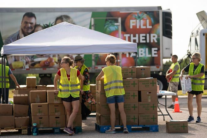 Central Texas Food Bank volunteers prepare to distribute free food to help people facing food insecurity.