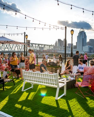 An artist concept shows what an outdoor patio will be like at a planned Cuban and Latina American fusion restaurant and rum bar Amador shows an Ohio River vista featuring the Downtown skyline from Newport on the Levee.