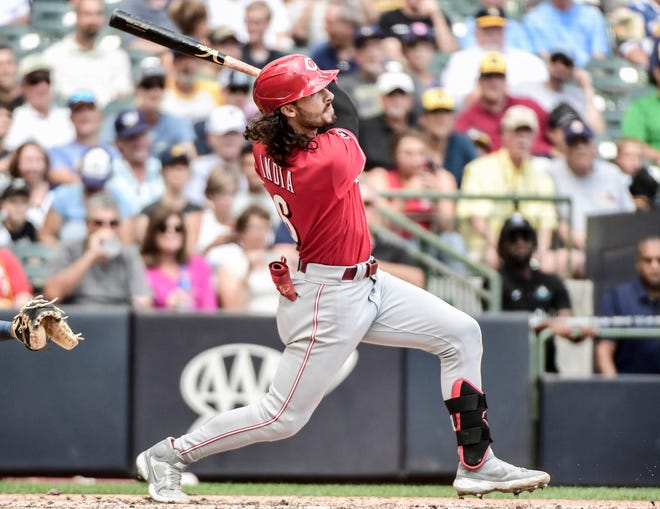 Aug 26, 2021; Milwaukee, Wisconsin, USA; Cincinnati Reds second baseman Jonathan India (6) hits a three run homer in the fifth inning against the Milwaukee Brewers at American Family Field. Mandatory Credit: Benny Sieu-USA TODAY Sports