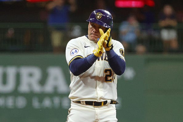 Avisail Garcia of the Milwaukee Brewers reacts to a base hit double during the fourth inning against the Cincinnati Reds at American Family Field on August 25, 2021 in Milwaukee, Wisconsin.