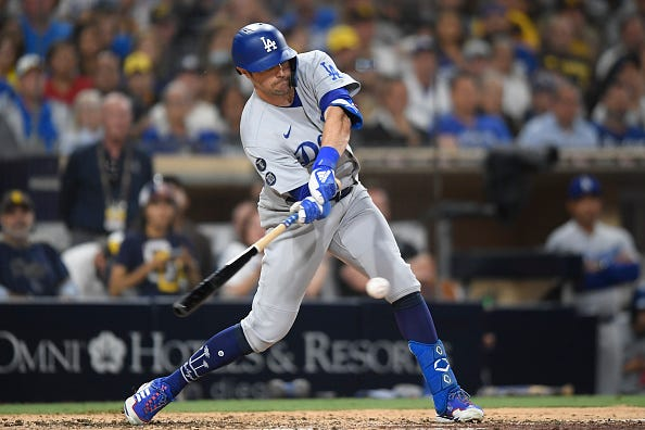 AJ Pollock of the Los Angeles Dodgers hits an RBI single during the seventh inning of a baseball game against the San Diego Padres at Petco Park on August 24, 2021 in San Diego, California.
