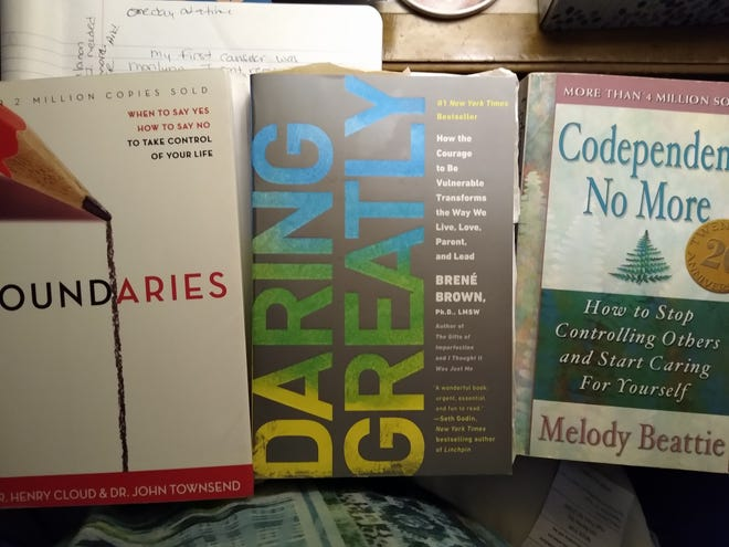 """Some of the self-help books Mary Anne used to work through her trauma include""""Boundaries: When to Say Yes, How to Say No to Take Control of Your Life,""""written by Henry Cloud and John Townsend; """"Daring Greatly: How the Courage to Be Vulnerable Transforms the Way We Live, Love, Parent, and Lead,""""written by BrenéBrown; and """"Codependent No More: How to Stop Controlling Others and Start Caring for Yourself,""""written by Melody Beattie."""
