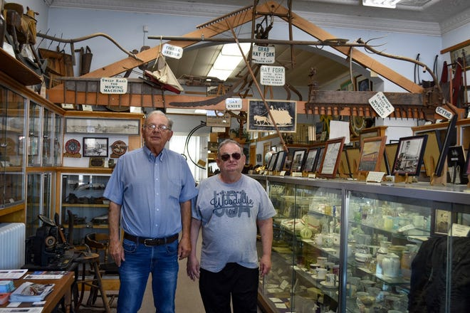 Woodville Historical Museum President Mike O'Connor, left, and museum volunteer Bruce Hudson stand amidst the museum's hundreds of artifacts. O'Connor is grateful for the dedicated people who help him maintain the museum, which is run entirely by volunteers.