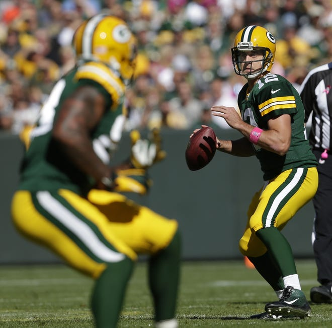 The jersey Green Bay Packers quarterback Aaron Rodgers is wearing in this game against the Detroit Lions in 2013 was auctioned for more than $40,000 on Saturday.