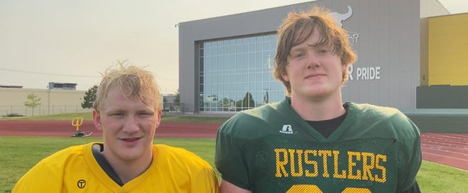 Senior wideout Tucker Harrison (left) sophomore Shawn Tadlock - the latter being the last remaining member of the 2020 C.M. Russell offensive line, takes a break from practice to talk football for the online series 'WALK THE TALK 2021'