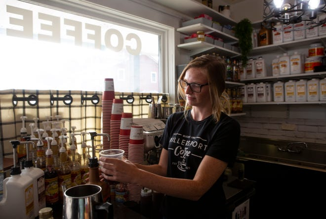 Barista Maddy Muck makes a Pumpkin Latte at a coffee shop in Millersport, Ohio.