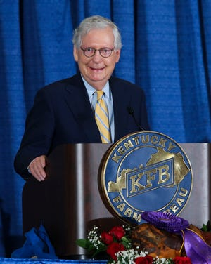U.S. Senator Mitch McConnell laughed after making a joke about the filibuster following Gov. Andy Beshear's lengthy remarks by video during the Kentucky Farm Bureau breakfast at the Kentucky State Fair in Louisville, Ky. on Aug. 26 2021.