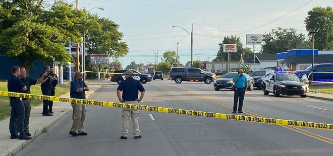 Police investigate the scene where a body was found early Thursday, Aug. 26, 2021, near 23rd and Madison streets in Muncie.