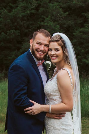 Nate and Faith Hargrove at their wedding Saturday at Front Porch Farms in north Dickson County.