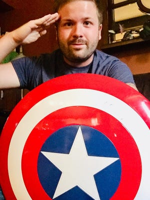 """Destin Richardson, of Newark, is a comic presenting a """"roast"""" of Thanos at Thirty One West. He plays Captain America."""