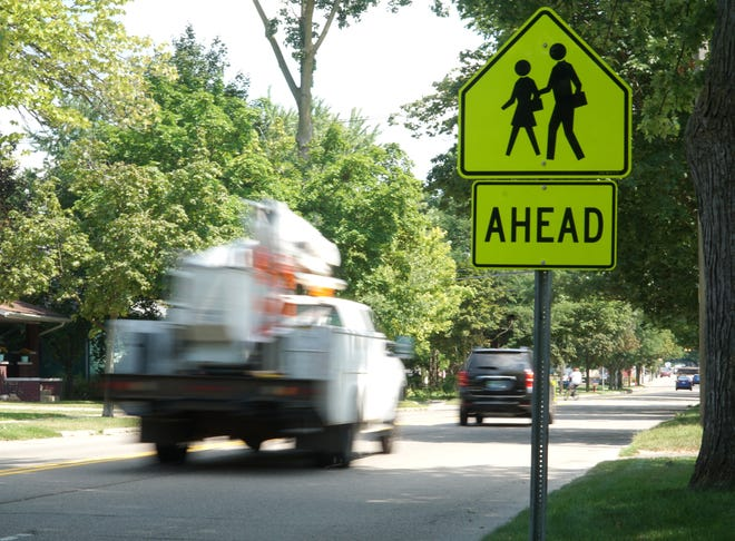 Traffic moves along Ten Mile Road west of Pontiac Trail. South Lyon is considering extra measures to limit speeding along Lake Street, also known as Ten Mile Road.