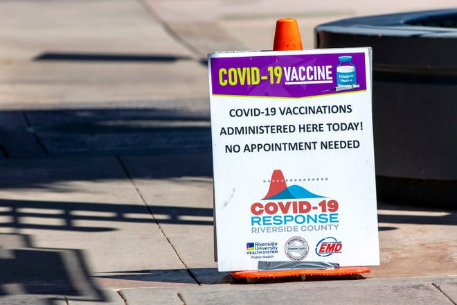 A sign placed on the sidewalk alerts people to a Riverside County COVID-19 vaccination clinic inside Roly China Fusion in Palm Springs, Calif., on August 26, 2021. No appointments were necessary at the mobile clinic.